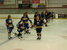 """There was a technical difficulty with a microphone at the start of the game so I decided to have some fun riling up the crowd.  The three """"Hanson Brothers"""" to my right as well as many of my teammates were trying to figure what the hell I was doing."""