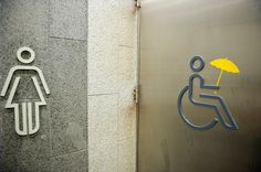 Umbrella Revolution Hong Kong, The handicaped toilet sign has been amended with the addition of an umbrella, in the toilets near pro-democracy 'Occupy Central' camp in Admirality, Hong Kong, on October 5, 2014. The 'Umbrella revolution' or 'Occupy Central' is a civil disobedience movement that began in response to China's decision to allow only Beijing-vetted candidates to stand in the city's 2017 election for the top civil position of chief executive.  (Photo by Lucas Schifres/Getty Images)