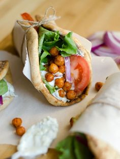 These Roasted Chickpea Gyros are a simple Mediterranean inspired wrap stuffed with spiced chickpeas and drizzled with refreshing tzatziki sauce.