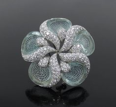 Presented is a unique Ambrosi diamond & aquamarine 18K white gold flower brooch. This unusual piece was made by Ambrosi. This amazing flower brooch features a large size design with special carved aquamarine leafs accented with diamonds. | eBay!