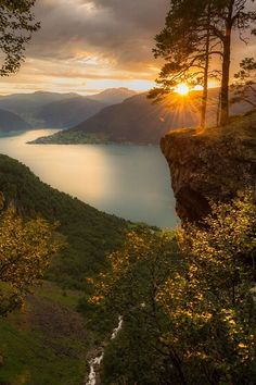 Sunset by the edge of the top of 715-ft/218m Feigefossen waterfall and view of the Lustra Fjord (Lustrafjorden), Norway - by JrnAllanPedersen on 500px