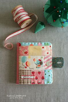 Patchwork needle book - I love the vintage nursery print!  R: Maybe add a scissor strap with snap