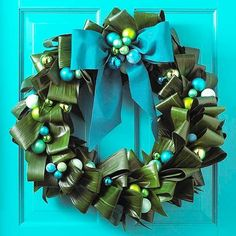 Green leaf wreath with ornaments