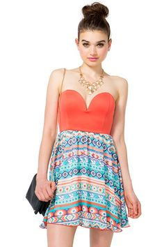 Standout in this flirty flared dress featuring a scuba knit bustier bodice and a tribal-printed chiffon skirt. Padded sweetheart bust with hidden underwire. Strapless. Elasticized back. Marrow finished short hem. Fully lined.