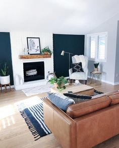 Navy blue accent, white fireplace, light wood floors, grey walls in the rest of the room! Navy Living Rooms, Blue Living Room Decor, Accent Walls In Living Room, New Living Room, My New Room, Living Room Designs, Navy And White Living Room, Living Room Wall Lighting, Navy Blue Rooms