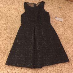 NWT Jennifer Lopez dress New with tags. Black dress with great details. Size 10 petite Jennifer Lopez Dresses Prom