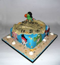 jake and the neverland pirates cake, would be cute with the figurines around the outside too, or standing where the parrot is.