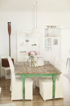 LOVE this rustic table with all white decor!