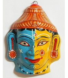 This mask depicts Rama and Sita, two characters from the popular Hindu epic called Ramayana.  Masks are commonly used during reenactments of this epic so that characters and their respective psyches can be properly depicted.  These masks often see the use of gold glitter thread and brass.