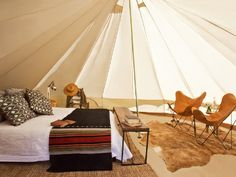 Luxury Camping- European canvas tents with classic decor and modern luxuries (leather butterfly chairs, chevron poufs), and communal gathering places (fire pits and fully stocked coolers). (Shelter Co.)
