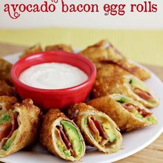 "Avocado Bacon Egg Rolls [RECIPE]  Ingredients 4 small avacados lime juice salt 6-7 slices pepperjack cheese 8-10 slices bacon, cooked 8-10 egg roll wrappers water Instructions In a large frying pan, heat about 2"" of oil on medium heat Slice avocados and drizzle with lime. Sprinkle with salt as desired. Place one egg roll wrapper on your work surface. Lay ½ of a slice of cheese in the middle. Lay 1 slice of avocado on top of cheese, and then one slice of bacon, broken in half. Finish with…"