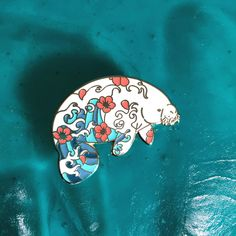 Jewelry Beautiful Manatee pin with pattern of coral flowers and waves. by Natelle Draws StuffHard Enamel, 2 rubber clutches, Jacket Pins, Cool Pins, Metal Pins, Pin And Patches, Up Girl, Pin Badges, Lapel Pins, Pin Collection, Bunt