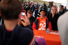Tony Carter, Denver Broncos cornerback, poses for photos with families Oct. 11 during a pre-game tailgate at Vista Ridge High School in Falcon School District 49. Vista Ridge High School is one of seven schools in Colorado hosting a Broncos Game of the Week this season. The Wolves raised $5,000 for the University of Colorado Cancer Center before the pink game, when they defeated, 63-0, the Kadets from Air Academy High School in Academy School District 20.