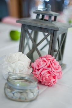Flower bundles and candle/latern centerpieces on tables, guests can write on rocks, quotes and tips on marriage