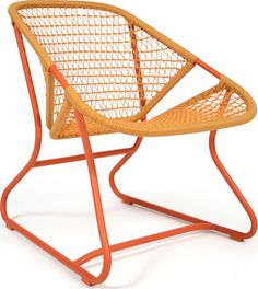 The Sixties Armchair has an aluminum tube frame and a high-density technical resin seat with a criss-cross weave. Features - Aluminum tubular frame - Extruded aluminum for armrest - Bright colored, wo