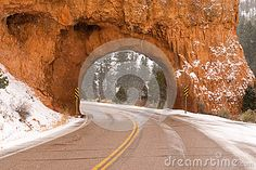 Snow falls at the tunnel on highway 12 heading through Red Canyon