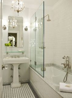 Gorgeous classic bathroom design with modern white porcelain sink with polished nickel base, white carrara marble basketweave tiles floor, glossy white subway tiles backsplash shower surround, open frameless glass shower and pendant. Bathroom Tub Shower, Tub Shower Combo, Master Shower, Bath Tub, Master Bathroom, Shower Over Bath, Relaxing Bathroom, Bathroom Marble, Bathroom Black
