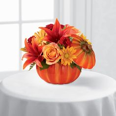 Our exclusive pumpkin container arrives with a lid to be a cherished keepsake long after the initial offering of flowers has faded to make this mixed flower bouquet a wonderful Thanksgiving, Halloween, birthday or thank you gift.