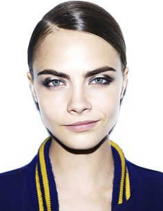 Smoky eyes and slicked back hair. Cara Delevingne can do no wrong.