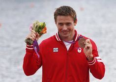 Mark Oldershaw proudly displays his bronze medalin the 1,000 metre singles canoe  at the London Olympics.
