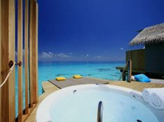 My husband to be suggested this place as our honeymoon <3 The sunken bathtub that overlooks ocean at the Centara Ras Fushi Resort & Spa in Maldives