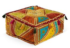 Vibrantly colored with mirrored details, this floor pillow is a marvel of high quality craftsmanship. Different fabrics form a harmonious patchwork pattern, accentuated by contrasting stitching, while colorful tassels embellish the sides.
