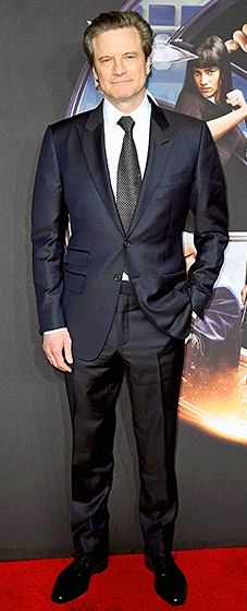 The handsome Brit premiered his action film while clad in a midnight blue suit and printed tie.