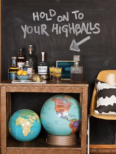 Bar cart & chalkboard wall & vintage globes