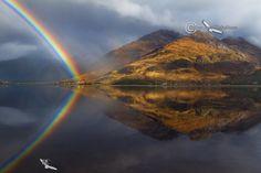 Loch Duich rainbow over Kintail . North West Highlands of Scotland.