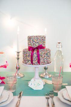 Colorful wedding cake covered in sprinkles | Photo by Stevi Sayler