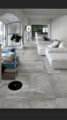 flooring concreto pulido Large concrete tiles for this clean interior - Interior Design Boards, Decor Interior Design, Interior Decorating, Room Interior, Living Divani, Concrete Interiors, Large Laundry Rooms, Style Deco, Home Decor Trends