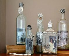 Tiny shells, decorative sand, or beads placed in the bottom, photo rolled inside, then seal wine bottle with decorative cork and trinkets.