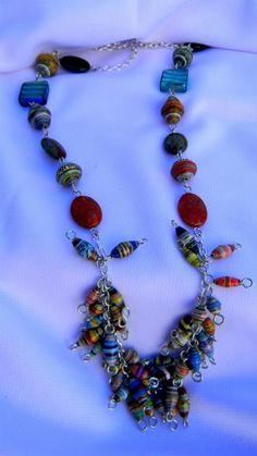 INSPIRATION: Paper Bead Necklace. Love the design at the bottom-beads in disarray.