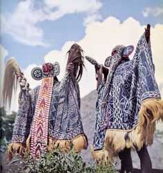 Bamileke masked dancers, Western Cameroon. From Parures Africaines; text by Denise Paulme and Jacques Brosse, photographs by M. Huet [et. al], 1956