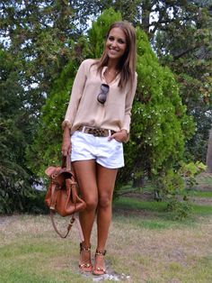 Pink shirt, white shorts, leopard sandals, brown handbag & belt