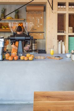 A Woodly Interior For This Juice Bar & Cafe In Bucharest