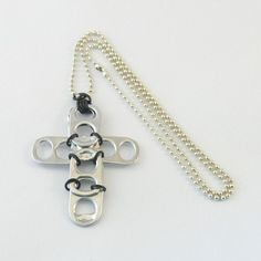 black pop tab cross necklace
