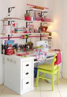Who says organization is boring? Touches of bright color add pop and pizazz to this small yet simple craft area. Shelves over the sewing desk add storage, and the addition of a pole through the bottom shelf bracket is a perfect spot to store rolls of ribbons and trims.