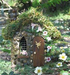 Fairy House - love the wire over the window...