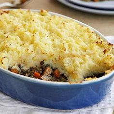 Golden Veggie Shepherd's Pie Recipe with butter, onion, carrots, celery, garlic cloves, chestnut mushrooms, bay leaves, dried thyme, green lentil, red wine, vegetable stock, tomatoes, potatoes, butter, milk, cheddar cheese