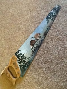 Hand painted saw blade two bucks fighting