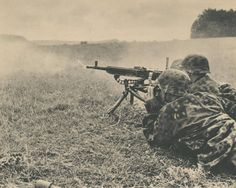 Two soldiers of the 3rd SS Totenkopf open fire against the enemy with a machine gun MG 37 (t) of Czechoslovakian origin (ZB vz. 37).