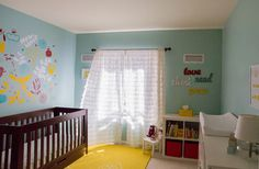 Aqua, yellow, and red nursery