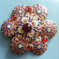 One giant colorful snowflake to match this New York winter blizzard. #cloisonné #enamel #buckle #vintage #color #newyork #metal  #bead #glass #paint #accessories #jewelry
