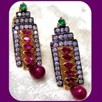 unusual shape and colour combo.. lusting after this pair of earrings...