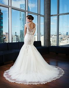 Justin Alexander 9730 Beaded lace over metallic silk creates a fit and flare gown that features a Bateau illusion neckline with ¾ length sleeves.  http://www.justinalexanderbridal.com/signature_wedding_dresses/9730