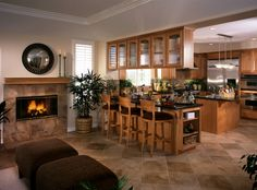 Wooden kitchen with peninsula and island.