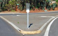Jim Grant was driving home in Carlsbad, California, when he came to a fork in the road ... an actual fork.  ...it was 6 feet high, made of wood, painted silver and mounted in the concrete island at the intersection of Levante Street and Anillo Way in south Carlsbad.  This is a picture Jim took that made its way to the internet ...