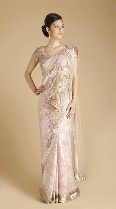 Stunning light pink georgette sari with embroidered peacock motif by Gaurav Gupta