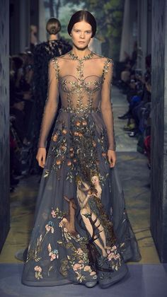 "Valentino spring 2014 couture collection- ""Le jardin d'Eden"", a zirconium-colored tulle dress, embroidered in silk threads, with a scene of Adam and Eve in the Garden of Eden inspired by the painting ""Adam and Eve"" by Lucas Cranach in 1526, taking 2,200 hours to hand embroider."